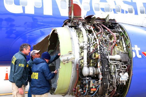 (NTSB via AP). National Transportation Safety Board investigators examine damage to the engine of the Southwest Airlines plane that made an emergency landing at Philadelphia International Airport in Philadelphia on Tuesday, April 17, 2018. The Southwes...