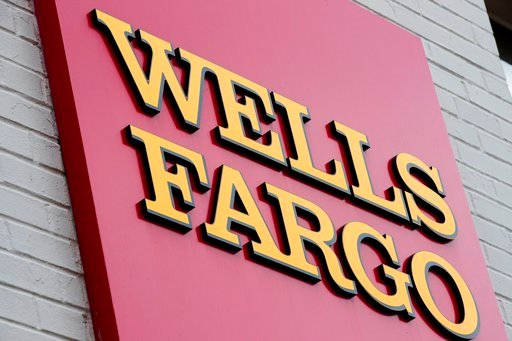 (AP Photo/Matt Rourke, File). FILE - This Aug. 11, 2017, file photo shows a sign at a Wells Fargo bank location in Philadelphia. The New York Times and other news outlets are reporting Thursday, April 19, 2018, that federal regulators plan to fine Well...
