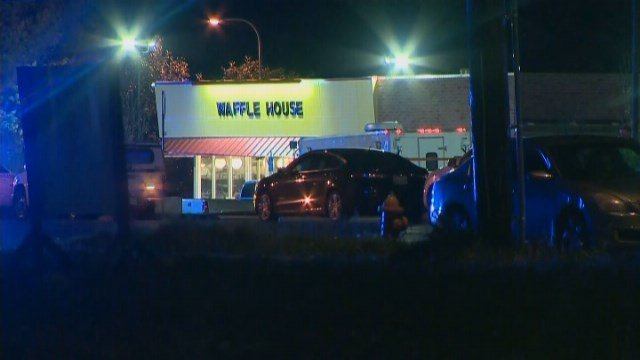 A customer at the restaurant took the gun from the suspect, who then took off his coat and fled the area. (Source: CNN)