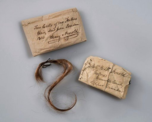 (Gavin Ashworth/Fort Ticonderoga via AP). This 2017 photo provided by Fort Ticonderoga shows a lock of Benedict Arnold's hair along with the paper wrappings that have enclosed it, at Fort Ticonderoga, in Ticonderoga, N.Y. The hair will be exhibited for...