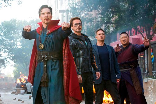 """(Marvel Studios via AP, File). FILE - This file image released by Marvel Studios shows, from left, Benedict Cumberbatch, Robert Downey Jr., Mark Ruffalo and Benedict Wong in a scene from """"Avengers: Infinity War."""" In its second weekend in theaters, """"Ave..."""
