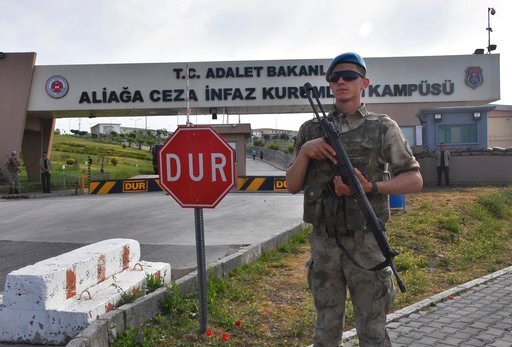 (DHA-Depo Photos via AP). A Turkish soldier guards the entrance to the prison complex in Aliaga, Izmir province, western Turkey, where jailed US pastor Andrew Craig Brunson is appearing on his trial at a court inside the complex, Monday, May 7, 2018.  ...