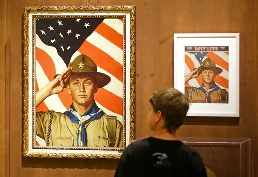 (AP Photo/Rick Bowmer, File). In this July 22, 2013, file photo, Andrew Garrison, 11, of Salt Lake City, looks over the Rockwell exhibition at the Mormon Church History Museum in Salt Lake City, Utah.