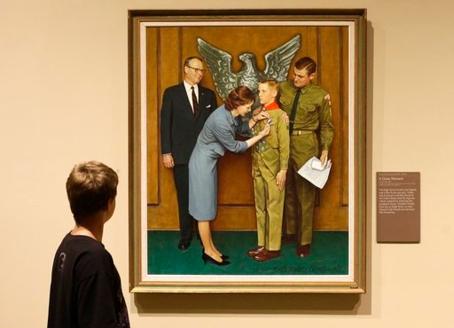 (AP Photo/Rick Bowmer, File). In this July 22, 2013, file photo, Andrew Garrison, 11, of Salt Lake City, looks over the Rockwell exhibition at the Mormon Church History Museum, in Salt Lake City, Utah.