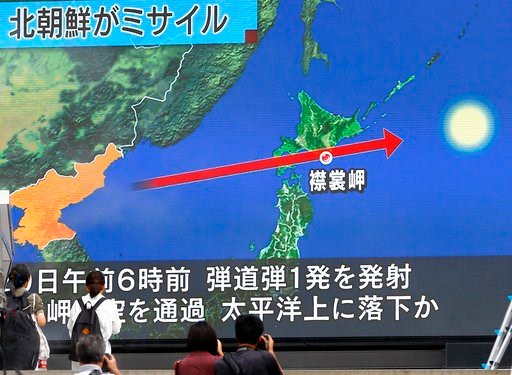 (AP Photo/Shizuo Kambayashi, File). In this Aug. 29, 2017, file photo, people walk by a TV news program reporting North Korea's missile launch, in Tokyo, Japan.