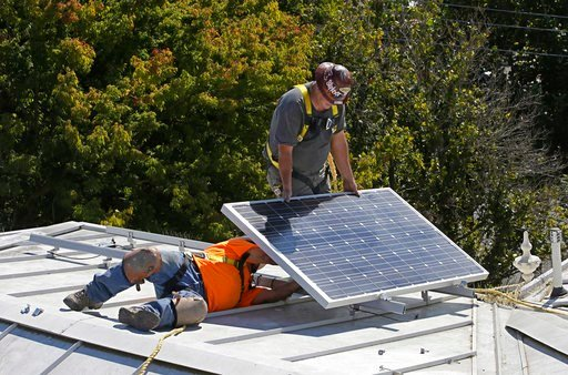 (AP Photo/Rich Pedroncelli, File). FILE-- In this Oct. 16, 2015 file photo a solar panel is installed on the roof of the Old Governor's Mansion State Historic Park in Sacramento, Calif. After extensive renovations, Gov. Jerry Brown and his wife, Anne G...