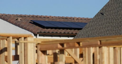 (AP Photo/Rich Pedroncelli). In this photo taken Monday, May 7, 2018, solar panels are seen on the rooftop on a home in a new housing project in Sacramento, Calif. The California Energy Commission will take up a proposal, Wednesday, May 9, 2018 , to re...