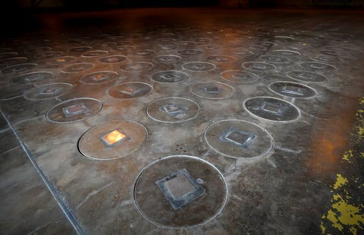 (AP Photo/Stephen B. Morton, File). File - In this Nov., 20, 2013 file photo, after radioactive waste is vitrified and sealed in large stainless steel canisters they are stored under a five-feet of concrete in a glass waste storage building at the Sava...