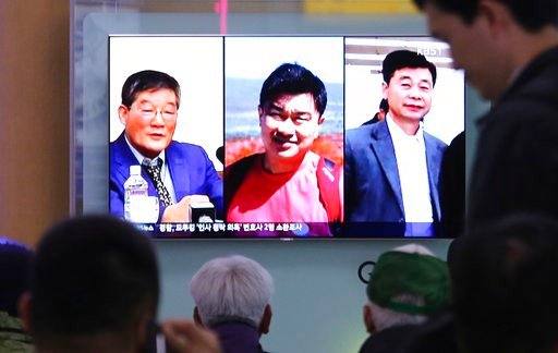 (AP Photo/Ahn Young-joon). In this May 3, 2018, photo, people watch a TV news report on screen, showing portraits of three Americans, Kim Dong Chul, left, Tony Kim and Kim Hak Song, right, detained in North Korea, at the Seoul Railway Station.