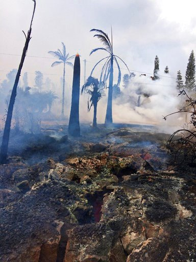 (U.S. Geological Survey via AP). This photo provided by the U.S. Geological Survey shows severe ground cracks associated with what's known as Fissure 14 beneath a burned-out landscape in Leilani Estates near the town of Pahoa, Hawaii, Wednesday, May 9,...