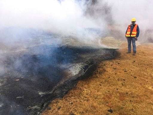 (U.S. Geological Survey via AP). In this Tuesday, May 8, 2018 photo from the U.S. Geological Survey, a geologist examines a part of the inactive fissure 10 in Leilani Estates subdivision near Pahoa on the island of Hawaii.