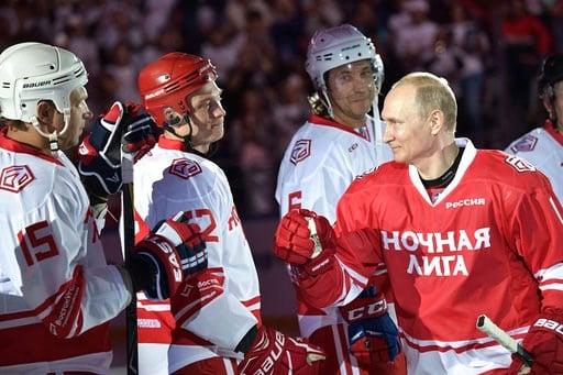(Alexei Nikolsky, Sputnik, Kremlin Pool Photo via AP). Russian President Vladimir Putin, right, takes part in a match of the Night Hockey League teams in the Bolshoy Ice Arena in the Black Sea resort of Sochi, Russia, Thursday, May 10, 2018.