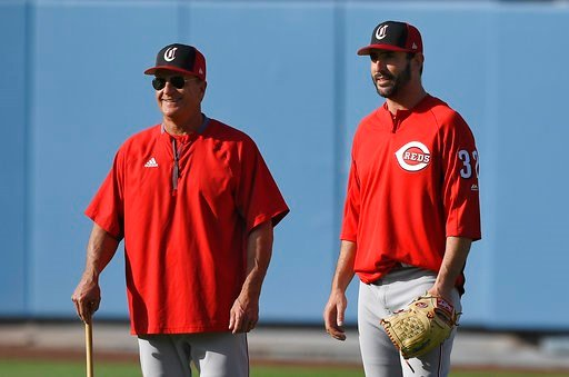 (AP Photo/Mark J. Terrill). Cincinnati Reds interim manager Jim Riggleman, left, talks with Matt Harvey prior to the team's baseball game against the Los Angeles Dodgers on Thursday, May 10, 2018, in Los Angeles.