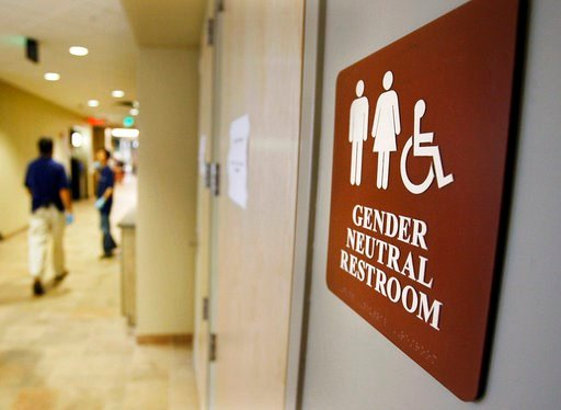 (AP Photo/Toby Talbot, File). FILE- In this Aug. 23, 2007, file photo, a sign marks the entrance to a gender-neutral restroom at the University of Vermont in Burlington, Vt. Gov. Phil Scott is expected to sign legislation, Friday, May 11, 2018, to requ...