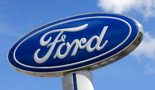 (AP Photo/Alan Diaz, File). FILE - This Jan. 17, 2017, file photo shows a Ford sign at an auto dealership, in Hialeah, Fla. There's no apparent signs that Wall Street is worried about a plant fire that is forcing Ford to cut back on production of its F...