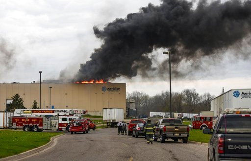 (Matthew Dae Smith/Lansing State Journal via AP, File). FILE - In this May 2, 2018, file photo, emergency personnel respond to a fire at Meridian Magnesium Products of America in Eaton Rapids, Mich. The fire that damaged the auto parts supply factory i...