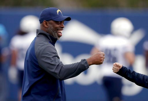 (AP Photo/Chris Carlson). Los Angeles Chargers coach Anthony Lynn smiles during the team's NFL football rookie minicamp Friday, May 11, 2018, in Costa Mesa, Calif.