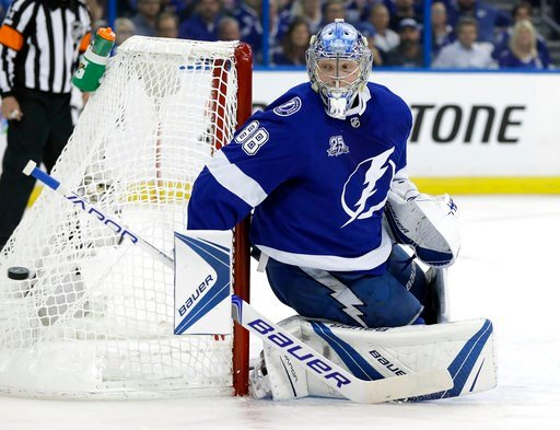 (AP Photo/Chris O'Meara). Tampa Bay Lightning goaltender Andrei Vasilevskiy (88) makes a stick save on a shot by the Washington Capitals during the first period of Game 1 of an NHL Eastern Conference final hockey playoff series Friday, May 11, 2018, in...
