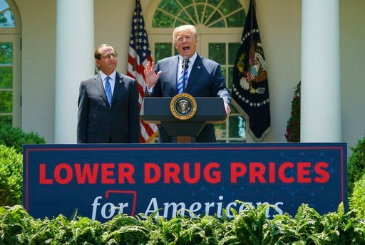 (AP Photo/Carolyn Kaster). President Donald Trump speaks during an event about prescription drug prices with Health and Human Services Secretary Alex Azar in the Rose Garden of the White House in Washington, Friday, May 11, 2018.