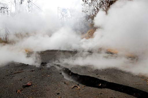 (AP Photo/Jae C. Hong). Toxic gases rise from cracks in the Leilani Estates subdivision near Pahoa, Hawaii, Friday, May 11, 2018. Kilauea has destroyed more than 35 structures since it began releasing lava from vents about 25 miles (40 kilometers) east...