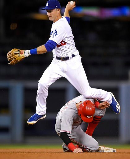 (AP Photo/Mark J. Terrill). Cincinnati Reds' Jesse Winker, below, is forced out at second as Los Angeles Dodgers second baseman Chase Utley aborts his throw to first on a ball hit by Jose Peraza during the sixth inning of a baseball game Friday, May 11...