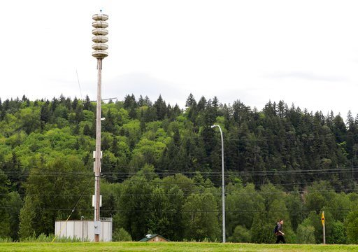 (AP Photo/Ted S. Warren). In this May 8, 2018 photo, a pedestrian walks past a lahar warning siren near Orting Middle School in Orting, Wash. The siren would sound if nearby Mount Rainier erupts or triggers a lahar mud flow, which could devastate the l...