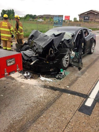 (South Jordan Police Department via AP). This Friday, May 11, 2018, photo released by the South Jordan Police Department shows a traffic collision involving a Tesla Model S sedan with a Fire Department mechanic truck stopped at a red light.