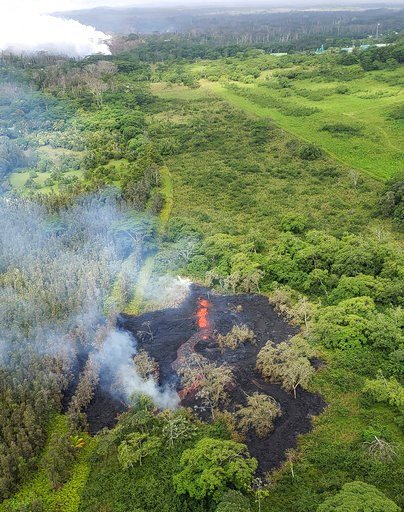 (Hawi'i County Fire Department via AP). This Saturday, May 12, 2018, image released by the Hawi'i County Fire Department, shows an aerial view of fissure 16, located about 1.3 km (0.8 miles) northeast of fissure 15, top left, i9n the Big Island of Hawa...