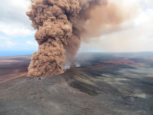 (U.S. Geological Survey via AP, File). File - In this Friday, May 4, 2018, file image released by the U.S. Geological Survey, at 12:46 p.m. HST, a column of robust, reddish-brown ash plume rises after an earthquake shook the Big Island of Hawaii, Hawai...