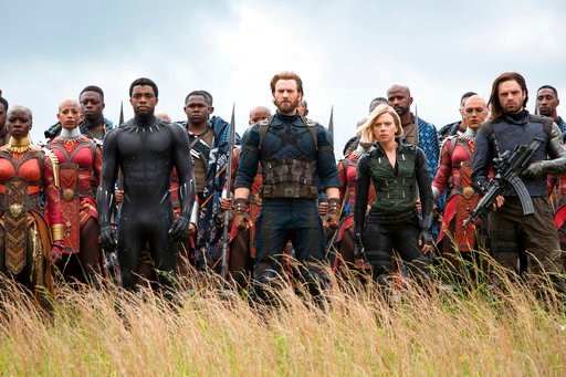 """(Chuck Zlotnick/Marvel Studios via AP). This image released by Marvel Studios shows, front row from left, Danai Gurira, Chadwick Boseman, Chris Evans, Scarlet Johansson and Sebastian Stan in a scene from """"Avengers: Infinity War."""""""