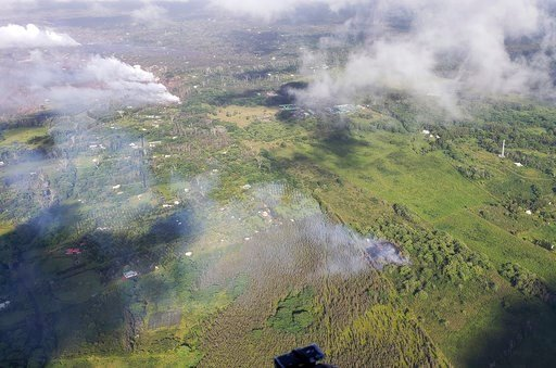 (Hawi'i County Fire Department via AP). This Saturday, May 12, 2018, aerial image released by the Hawi'i County Fire Department, show a view of fissure 16, bottom right, that erupted this morning beginning just before 7:00 a.m. HST in the Big Island of...
