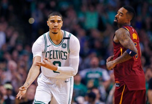 (AP Photo/Michael Dwyer). Boston Celtics forward Jayson Tatum (0) celebrates his three-point basket as Cleveland Cavaliers guard JR Smith (5) looks on during the second quarter of Game 1 of the NBA basketball Eastern Conference Finals, Sunday, May 13, ...