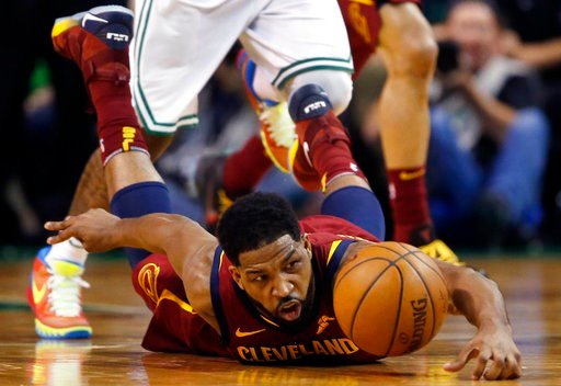 (AP Photo/Michael Dwyer). Cleveland Cavaliers center Tristan Thompson dives for the ball during the first half of Game 1 of the NBA basketball Eastern Conference Finals against the Boston Celtics, Sunday, May 13, 2018, in Boston.