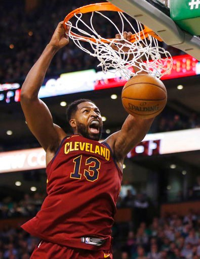 (AP Photo/Michael Dwyer). Cleveland Cavaliers center Tristan Thompson (13) dunks during the first half of Game 1 of the NBA basketball Eastern Conference Finals against the Boston Celtics, Sunday, May 13, 2018, in Boston.