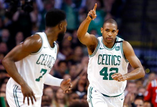 (AP Photo/Michael Dwyer). Boston Celtics forward Al Horford (42) celebrates a made basket with guard Jaylen Brown (7) during the first quarter of Game 1 of the NBA basketball Eastern Conference Finals against the Cleveland Cavaliers, Sunday, May 13, 20...