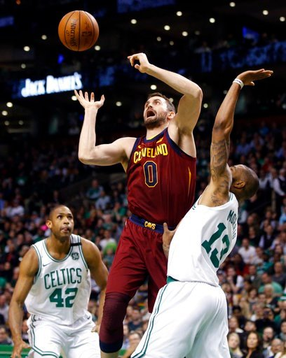(AP Photo/Michael Dwyer). Cleveland Cavaliers center Kevin Love (0) loses control of the ball against the defense of Boston Celtics forwards Al Horford (42) and Marcus Morris (13) during the first quarter of Game 1 of the NBA basketball Eastern Confere...