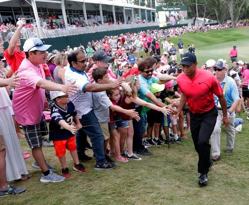(AP Photo/Lynne Sladky). Fans greet Tiger Woods as he exits the 18 hole, during the final round of The Players Championship golf tournament Sunday, May 13, 2018, in Ponte Vedra Beach, Fla.