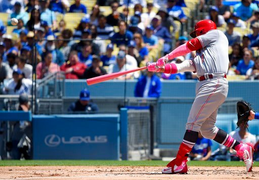 (AP Photo/Mark J. Terrill). Cincinnati Reds' Eugenio Suarez hits a two-run home run during the third inning of a baseball game against the Los Angeles Dodgers, Sunday, May 13, 2018, in Los Angeles.