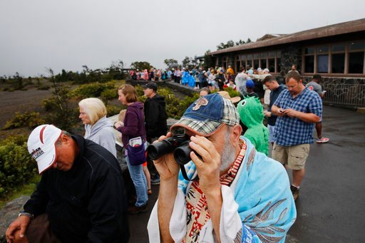 (AP Photo/Jae C. Hong, File). File - In this May 10, 2018 file photo visitors view Kilauea's summit crater outside the Jaggar Museum in Volcanoes National Park, Hawaii. Kilauea has long towered over this corner of the Big Island, and is a source of pri...
