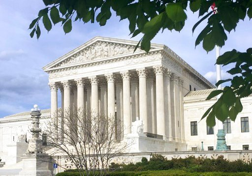 (AP Photo/Jessica Gresko). In this April 23, 2018 file photo, the Supreme Court in Washington. The Supreme Court has struck down a federal law that bars gambling on football, basketball, baseball and other sports in most states, giving states the go-ah...