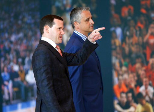 (AP Photo/Matt York). Phoenix Suns new head coach Igor Kokoskov, right, arrives with general manager Ryan McDonough to speak to the media Monday, May 14, 2018, in Phoenix. Kokoskov will oversee a vastly improved team after they compiled the worst recor...