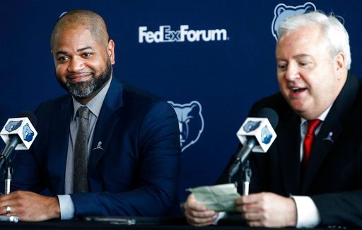 (Mark Weber/The Commercial Appeal via AP). J.B. Bickerstaff, left, smiles as he is introduced as the team's new head coach by Memphis Grizzlies general manager Chris Wallace at a press conference in Memphis, Tenn., Wednesday, May 2, 2018.