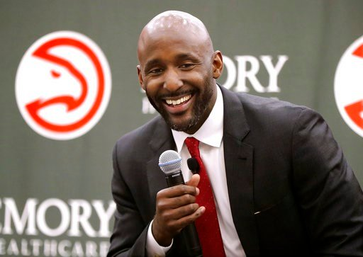 (Curtis Compton/Atlanta Journal-Constitution via AP). Lloyd Pierce smiles as the Atlanta Hawks introduce him as a full-time coach on Monday, May 14, 2018, in Atlanta. Pierce joins the Hawks after spending the past five seasons as an assistant coach wit...