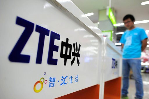 (Chinatopix via AP, File). FILE - In this Oct. 8, 2012, file photo, a salesperson stands at counters selling mobile phones produced by ZTE Corp. at an appliance store in Wuhan in central China's Hubei province. President Donald Trump's weekend social m...
