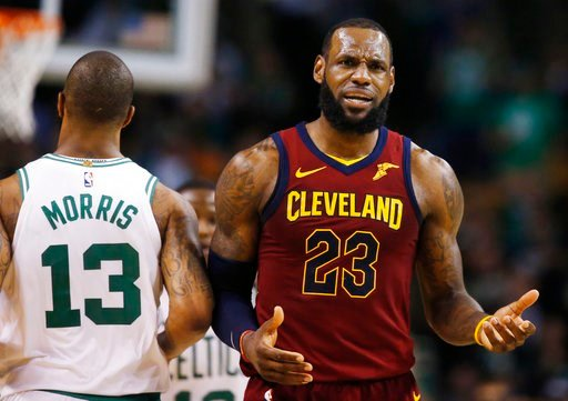 (AP Photo/Michael Dwyer). Cleveland Cavaliers forward LeBron James (23) reacts next to Boston Celtics forward Marcus Morris (13) during the third quarter of Game 1 of the NBA basketball Eastern Conference Finals, Sunday, May 13, 2018, in Boston.