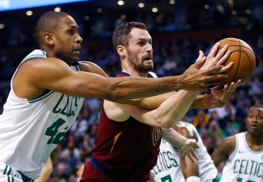 (AP Photo/Michael Dwyer). Boston Celtics forward Al Horford (42) and Cleveland Cavaliers center Kevin Love compete for control of the ball during the first quarter of Game 1 of the NBA basketball Eastern Conference Finals, Sunday, May 13, 2018, in Bost...