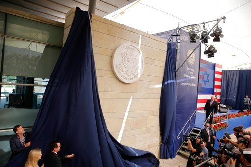 (AP Photo/Sebastian Scheiner). U.S. President Donald Trump's daughter Ivanka Trump, left, and U.S. Treasury Secretary Steve Mnuchin unveil an inauguration plaque during the opening ceremony of the new US embassy in Jerusalem, Monday, May 14, 2018.
