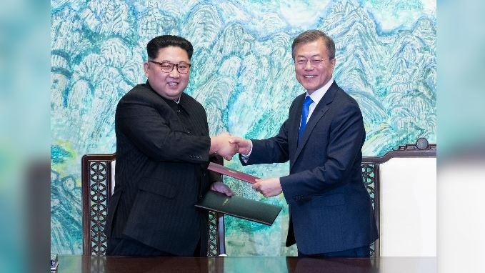 In this April 27, 2018, photo, North Korean leader Kim Jong Un, left, and South Korean President Moon Jae-in shake hands after signing a joint statement at the village of Panmunjom in the Demilitarized Zone, South Korea. (Korea Summit Press Pool via AP)