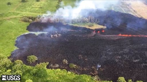 (U.S. Geological Survey via AP). In this May 13, 2018 frame from video released by the U.S. Geological Survey, gases rise from a fissure near Pahoa, Hawaii. The new fissure sent gases and lava exploding into the air, spurring officials to call for more...