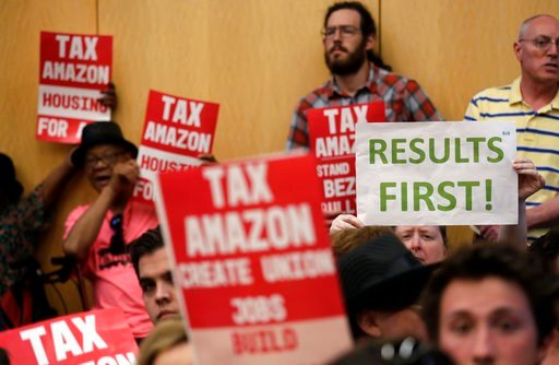 "(AP Photo/Elaine Thompson). People fill seats before a Seattle City Council meeting where the council was expected to vote on a ""head tax"" Monday, May 14, 2018, in Seattle."